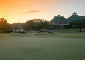 sunrise over the 18th hole on a golf course